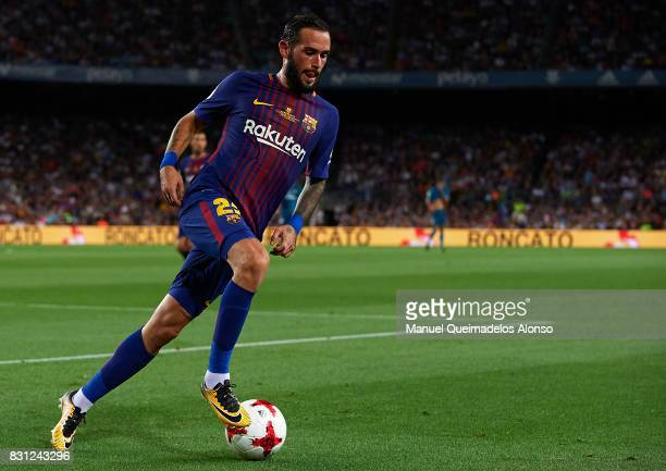 Aleix Vidal of Barcelona runs with the ball during the Supercopa de Espana Supercopa Final 1st Leg match between FC Barcelona and Real Madrid at Camp...