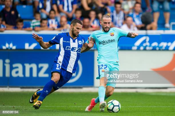 Aleix Vidal of FC Barcelona duels for the ball with Alfonso Pedraza of Deportivo Alaves during the La Liga match between Deportivo Alaves and...