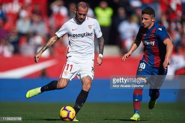 Aleix Vidal of Sevilla FC being followed by Enis Bardhi of Levante UD during the La Liga match between Sevilla FC and Levante UD at Estadio Ramon...