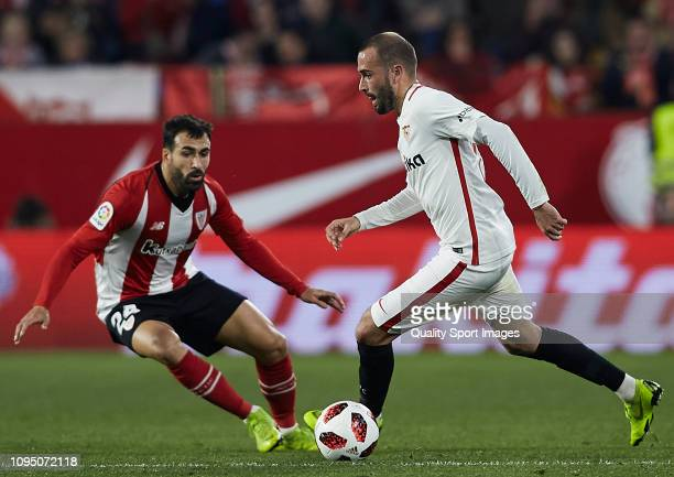Aleix Vidal of Sevilla FC competes for the ball with Balenziaga of Ahtletic Club de Bilbao during the Copa del Rey Round of 16 match between Sevilla...