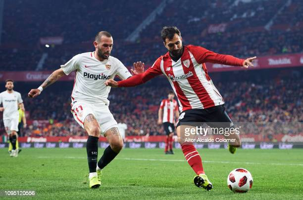 Aleix Vidal of Sevilla FC competes for the ball with Mikel Balenziaga of Athletic Club during the Copa del Rey Round of 16 second leg match between...