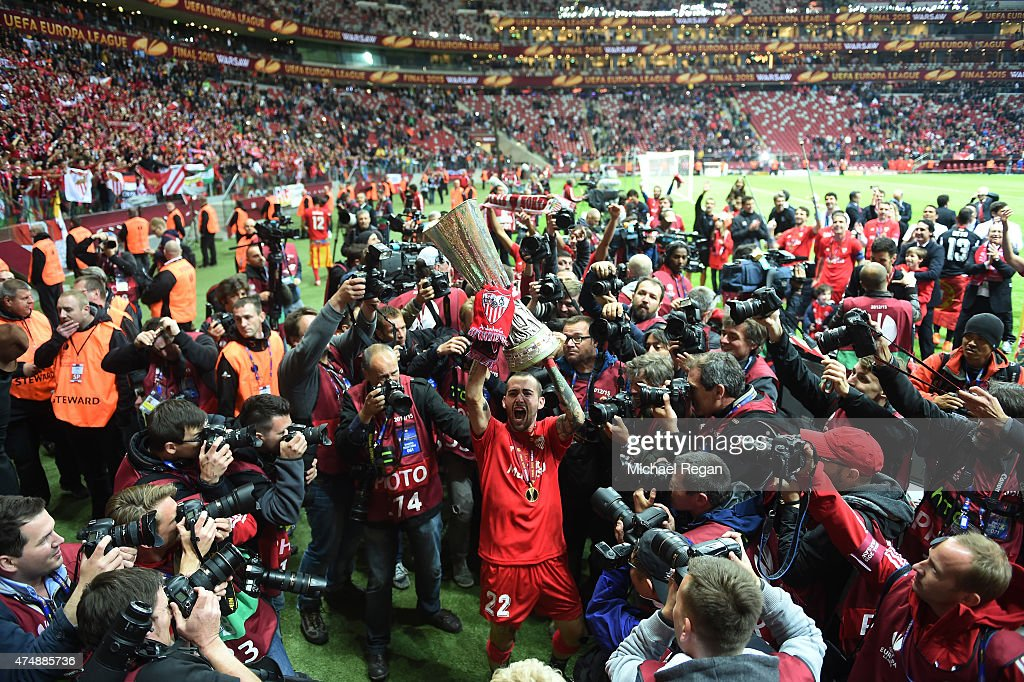 Aleix Vidal of Sevilla lifts the trophy as he celebrates victory after the UEFA Europa League Final match between FC Dnipro Dnipropetrovsk and FC Sevilla on May 27, 2015 in Warsaw, Poland.