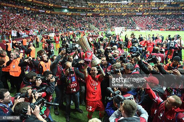 Aleix Vidal of Sevilla lifts the trophy as he celebrates victory after the UEFA Europa League Final match between FC Dnipro Dnipropetrovsk and FC...