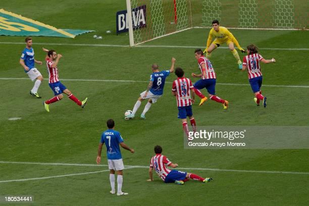 Aleix Vidal Parreu of UD Almeria scores their second goal during the La Liga match between Club Atletico de Madrid and UD Almeria at Vicente Calderon...