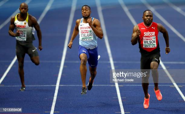 Aleixo Platini Menga of Germany Nethaneel MitchellBlake of Great Britain and Alex Wilson of Switzerland compete in the Men's 200m SemiFinal during...
