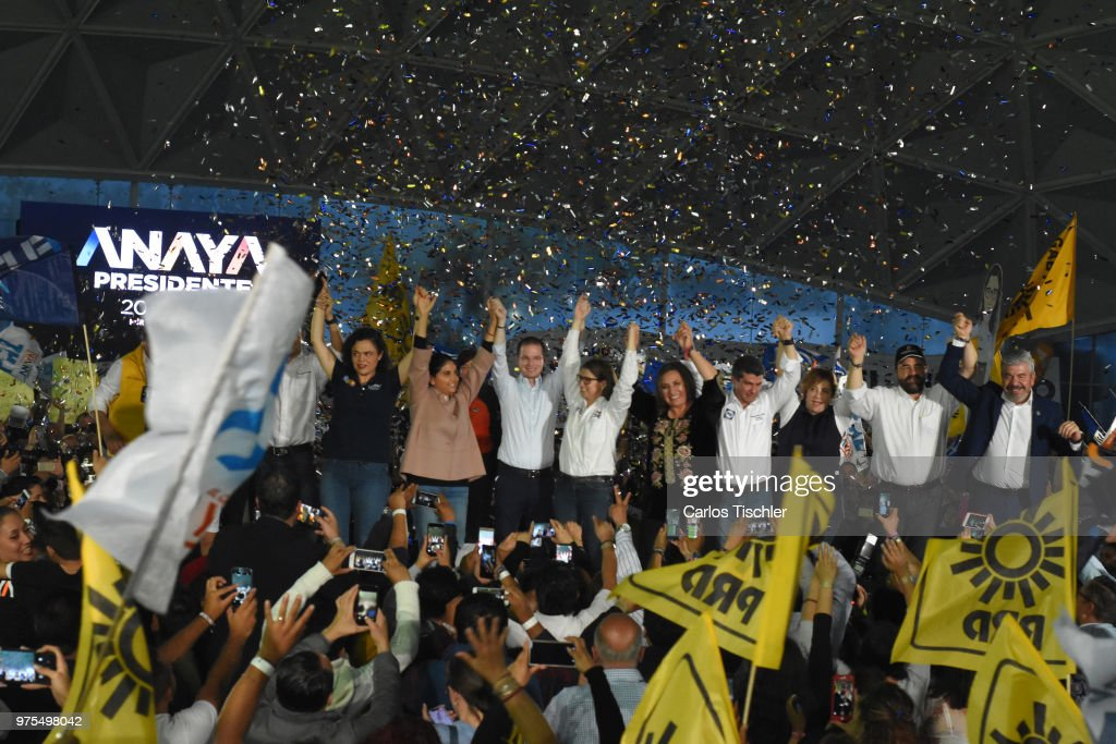 Alejandra Barrales, Ricardo Anaya, Magui Fisher and Xochitl Galvez, candidates for Coalition for Mexico to the Front raise their hands during a Civic Gathering as part of Ricardo Anaya's election campaign at Deportivo Plan Sexenal on June 13, 2018 in Mexico City, Mexico.