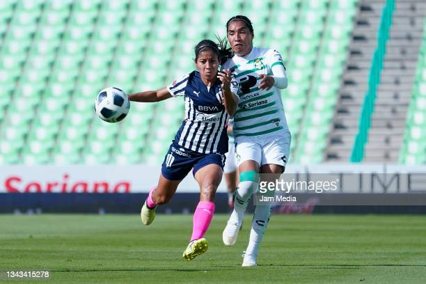 Alejandra Calderon of Monterrey fights for the ball with Estela Gomez of Santos during a match between Santos and Monterrey as part of the Torneo...