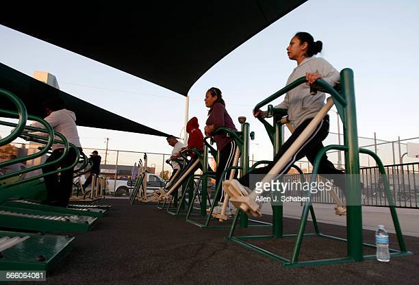 Alejandra Gonzalez right and her sister Carla Gonzalez to the left of her both of Huntington Park use the air walker machines to exercise at the...