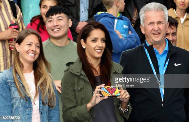 Alejandra Gutierrez wife of Jamie Murray of Great Britain watches on after he and his partner Bruno Soares of Brazil defeat Julien Benneteau of...