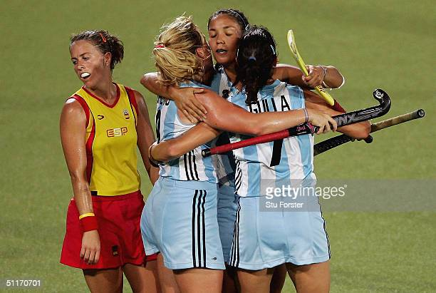 Alejandra Laura Gulla Vanina Paula Oneto and Agustina Soledad Garcia of Argentina celebrate victory in front of Silvia Munoz of Spain in the women's...