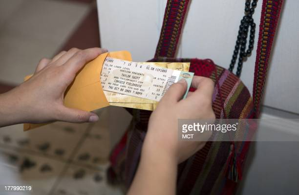Alejandra Pinzon look at Taylor Swift tickets from a concert she attended in 2005 in the United States in her apartment in Mexico City June 23 2013...