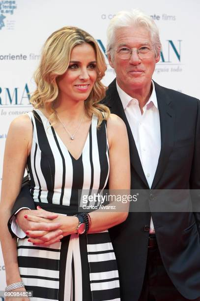 Alejandra Silva and actor Richard Gere attend the 'Norman: The Moderate Rise and Tragic Fall of a New York Fixer' premiere at the Callao cinema on...