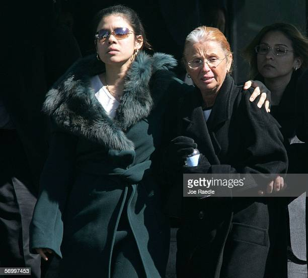Alejandra St Guillen and her mother Maureen St Guillen exit the Gormley Funeral Home after attending the funeral service for their sister/daughter...