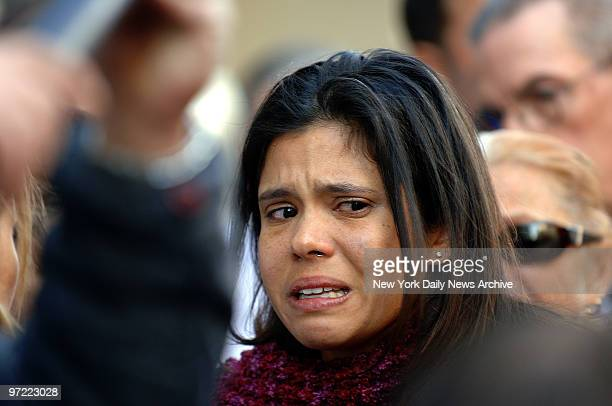 Alejandra St Guillen sister of slain grad student Imette St Guillen cries while outside Brooklyn Supreme Court where Darryl Littlejohn was arraigned...