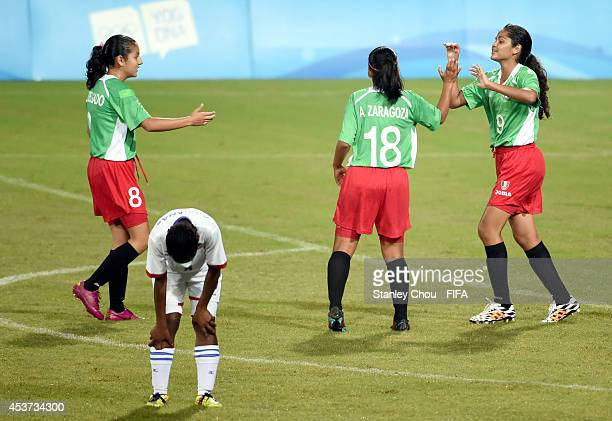 Alejandra Zaragoza#18 of Mexico celebrates with her teammates after scoring against Namibia during the FIFA Girls Summer Olympic Football Tournament...