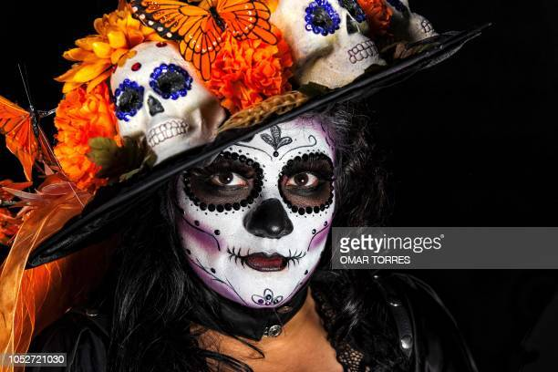 Alejandria Copado poses for a photograph disguised as Catrina before the March of Catrinas organized by Body Paint group in Mexico city on October 21...