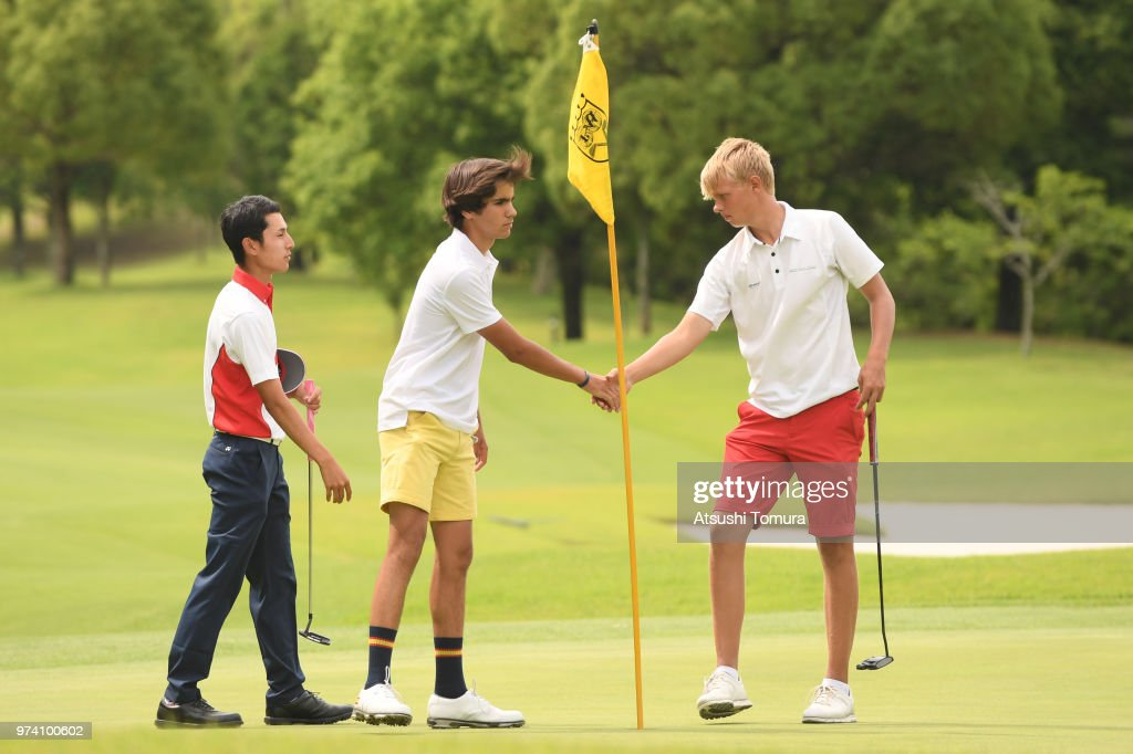 Alejandro Aguilera Martin of Spain (L) and Sebastian Friedrichsen of Denmark (R) shake hands during the third round of the Toyota Junior Golf World Cup at Chukyo Golf Club on June 14, 2018 in Toyota, Aichi, Japan.