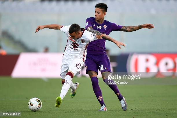 Alejandro 'Alex' Berenguer of Torino FC is challenged Erick Pulgar of ACF Fiorentina during the Serie A football match between ACF Fiorentina and...