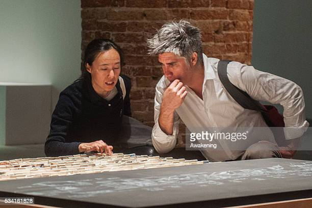 Alejandro Aravena curator of the 15th Architecture Venice Biennale look the installations of the Reporting from the Front pavillon on May 25 2016 in...
