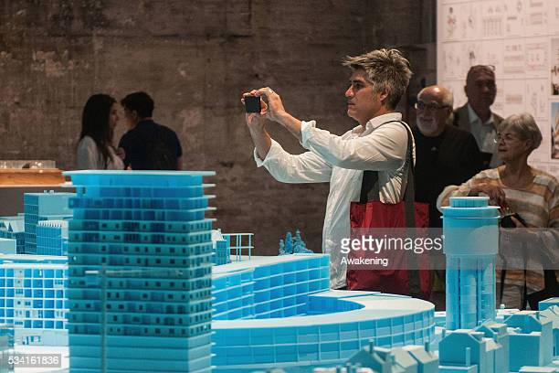 Alejandro Aravena curator of the 15th Architecture Venice Biennale looks at the installations of the Reporting from the Front pavillon on May 25 2016...