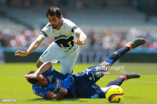 Alejandro Arribas of Pumas and Lucas Cavallini of Puebla fight for the ball during the 15th round match between Pumas UNAM and Puebla as part of the...