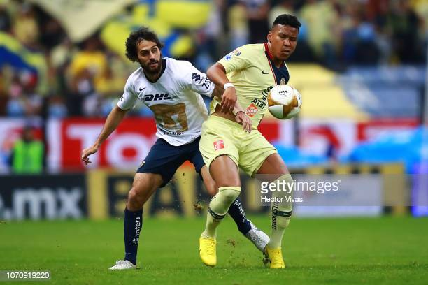 Alejandro Arribas of Pumas struggles for the ball with Roger Martinez of America during the semifinal second leg match between America and Pumas UNAM...