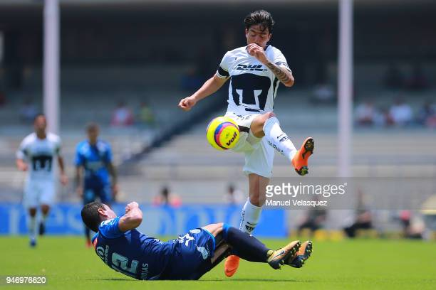 Alejandro Arribas of Pumas strugles for the ball against Oscar Rojas of Puebla during the 15th round match between Pumas UNAM and Puebla as part of...