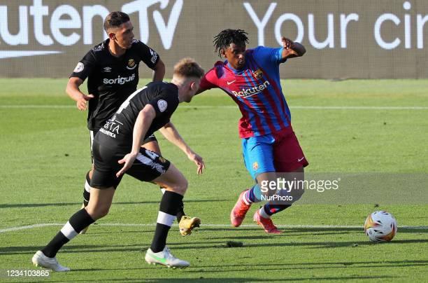 Alejandro Balde and Pol during the friendly match between FC Barcelona and Club Gimnastic de Tarragona, played at the Johan Cruyff Stadium on 21th...