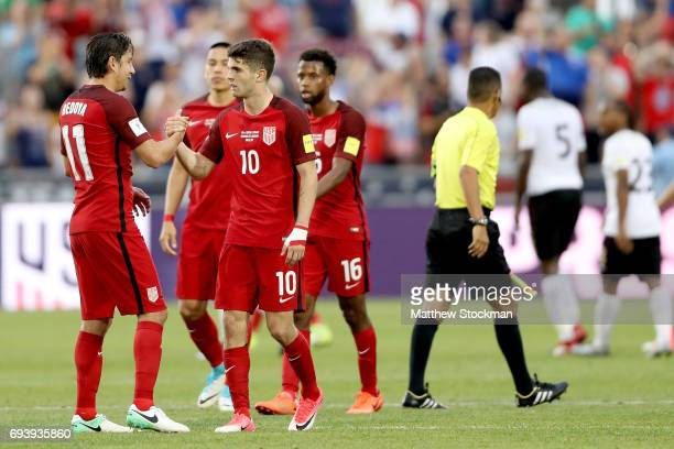 Alejandro Bedova and Christian Pulisic of the US National Team celebrate their win over Trinidad Tabago during the FIFA 2018 World Cup Qualifier at...