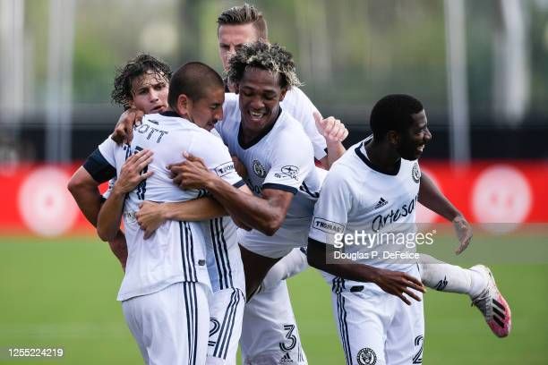 Alejandro Bedoya of Philadelphia Union celebrates with his teammates after scoring a goal during the second half of the game against the New York...