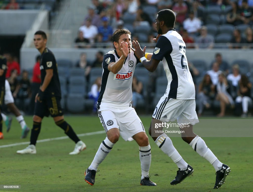 Alejandro Bedoya #11 of Philadelphia Union celebrates with teammate Marcus Epps #20 after a goal by teammate Fafa Picault #9 (not in photo) as Eduard Atuesta #20 of Los Angeles FC looks on during the first half of their MLS match at Banc of California Stadium on June 30, 2018 in Los Angeles, California. Los Angeles FC defeated the Philadelphia Union 4-1.