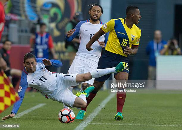 Alejandro Bedoya of the United States goes to the ground after tangling with Antonio Valencia of Ecuador during a Quarterfinal match between USA and...
