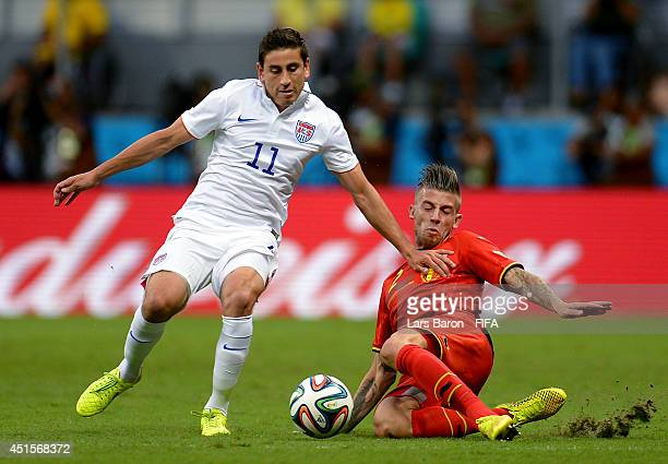 Alejandro Bedoya of the United States is tackled by Toby Alderweireld of Belgium during the 2014 FIFA World Cup Brazil Round of 16 match between...