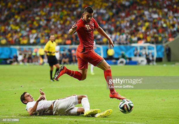 Alejandro Bedoya of the United States tackles Kevin Mirallas of Belgium during the 2014 FIFA World Cup Brazil Round of 16 match between Belgium and...
