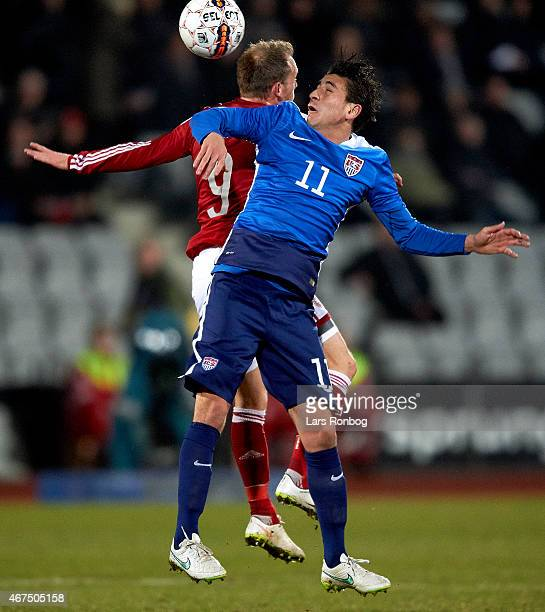 Alejandro Bedoya of United States and Michael KrohnDehli of Denmark compete for the ball during the International Friendly match between Denmark and...