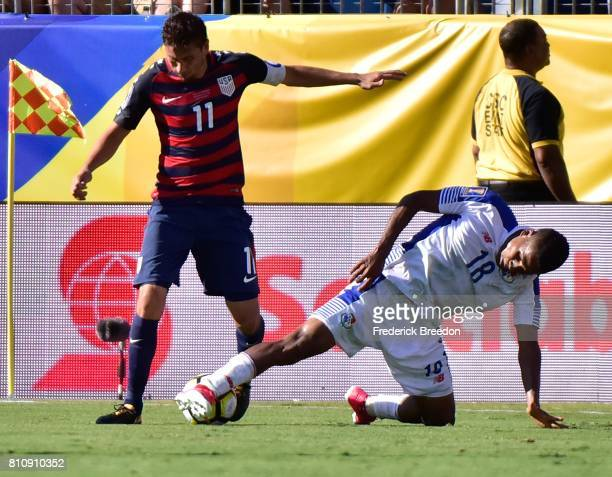 Alejandro Bedoya of USA and Miguel Camargo of Panama fight for the ball during the second half of a CONCACAF Gold Cup Soccer match at Nissan Stadium...