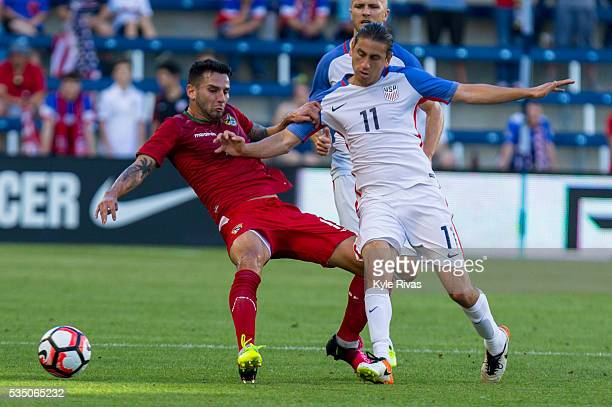 Alejandro Bedoya of USA knocks down Alejandro Meleán of Bolivia in the first half of an international friendly match between Bolivia and the United...