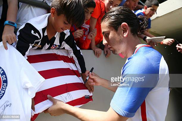 Alejandro Bedoya of USA signs a jersey for a kid prior an international friendly match between Puerto Rico and USA at Juan Ramon Loubriel Stadium on...