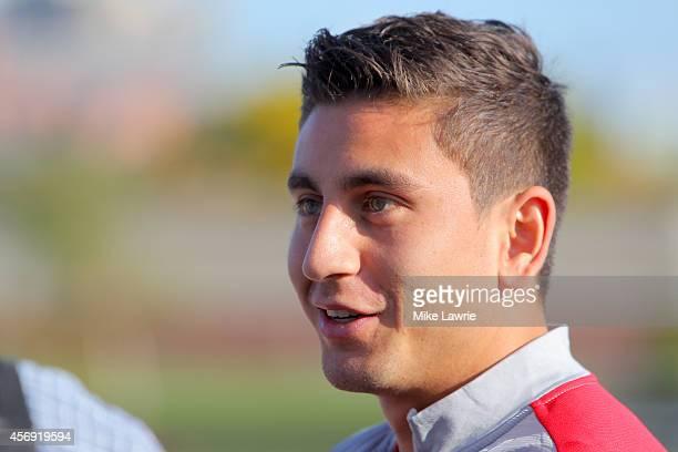 Alejandro Bedoya speaks to the media during a United States soccer training session at Ohiri Field on October 8 2014 in Boston Massachusetts