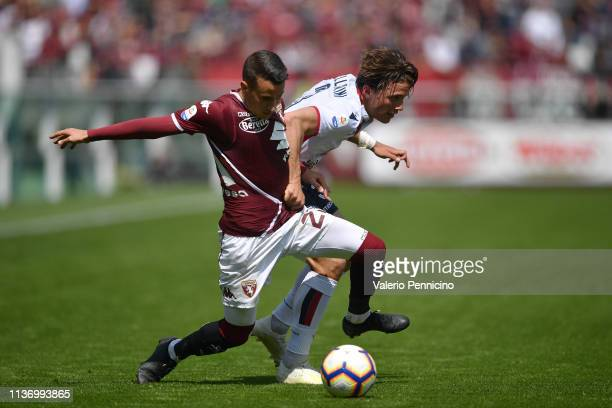 Alejandro Berenguer of Torino FC competes with Luca Pellegrini of Cagliari during the Serie A match between Torino FC and Cagliari at Stadio Olimpico...