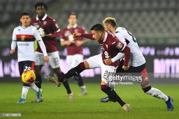 Alejandro Berenguer of Torino FC is challenged by Valon Behrami of Genoa CFC during the Coppa Italia match between Torino FC and Genoa CFC at Stadio...