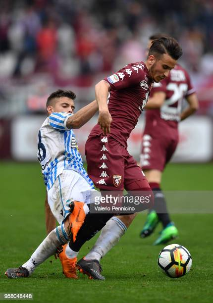 Alejandro Berenguer of Torino FC is tackled by Alberto Grassi of Spal during the Serie A match between Torino FC and Spal at Stadio Olimpico di...