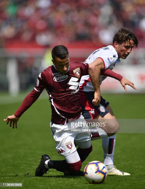 Alejandro Berenguer of Torino FC is tackled by Luca Pellegrini of Cagliari during the Serie A match between Torino FC and Cagliari at Stadio Olimpico...