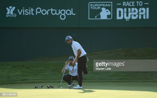 Alejandro Canizares of Spain and Juan Postigo line up a putt during the EDGA competition follwoing the third round of the Portugal Masters at the Dom...