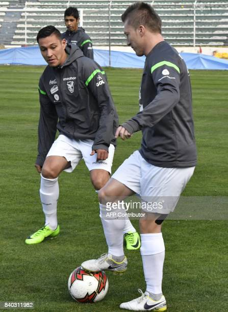 Alejandro Chumacero and Juan Eduardo Fierro take part in a training session at the Hernando Siles stadium in La Paz on August 28 ahead of Bolivia's...