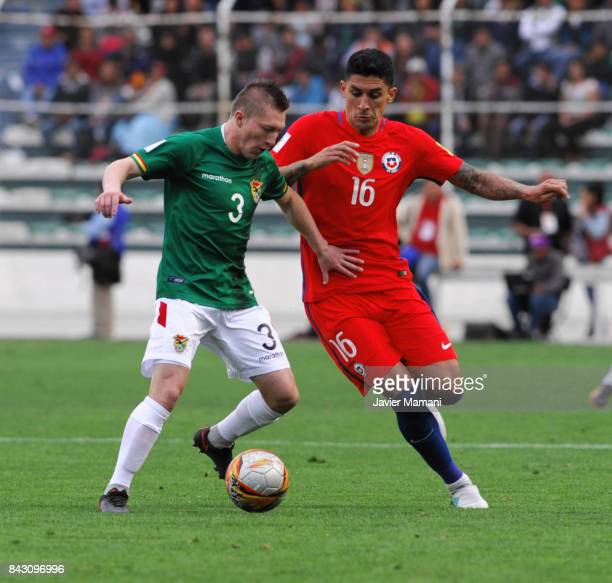 Alejandro Chumacero of Bolivia fights for the ball with Pedro Hernandez of Chile during a match between Bolivia and Chile as part of FIFA 2018 World...