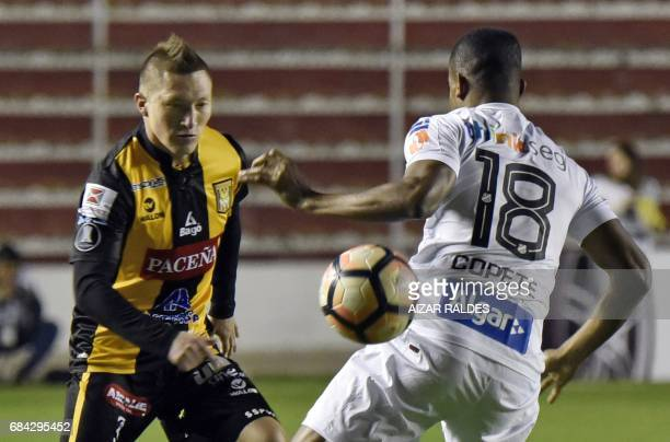Alejandro Chumacero of Bolivia's The Strongest vies for the ball with Jonathan Copete of Brazilian Santos during a Copa Libertadores football match...