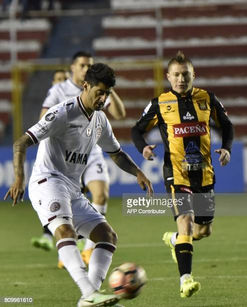 Alejandro Chumacero of Bolivia's The Strongest vies for the ball with Román Fernando Martínez of Argentina's Lanus during their Copa Libertadores...