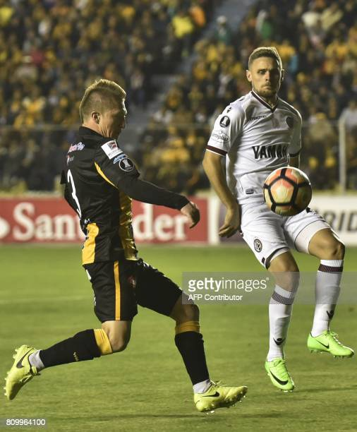 Alejandro Chumacero of Bolivia's The Strongest vies for the ball with Nicolás Pasquini of Argentine Lanus during their Copa Libertadores football...