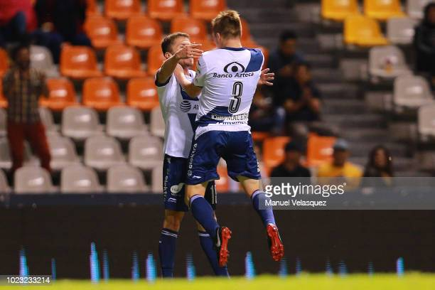 Alejandro Chumacero of Puebla celebrates with teammate Diego Cruz after scoring the first goal of his team during the 6th round match between Puebla...